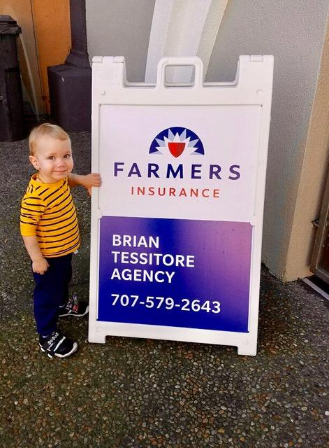 My son in front of Farmers sign