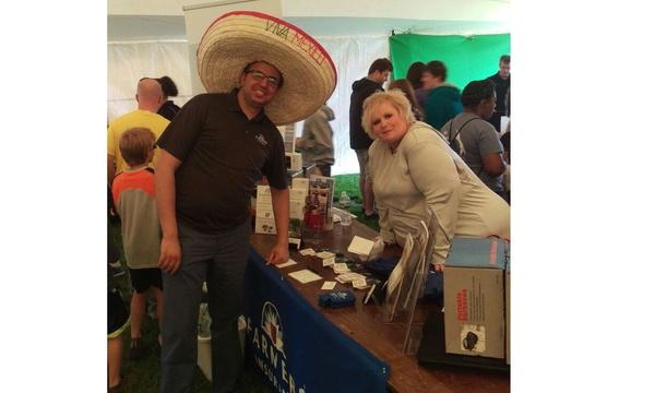 Agent Adil with female staff member at a Farmers booth for Nisk day.