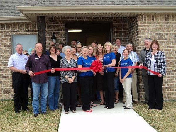 Ribbon cutting at new office in Lumberton.