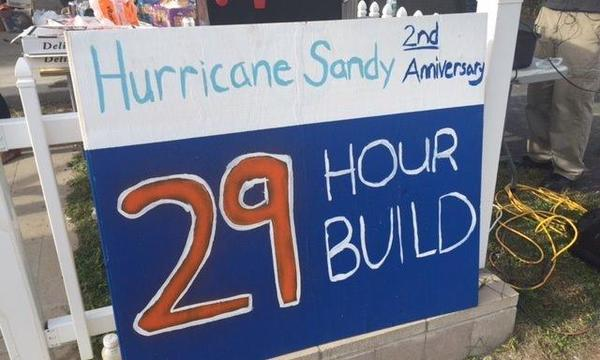 "Sign reading ""Hurricane Sandy 2nd Anniversary - 29 Hour Build"""