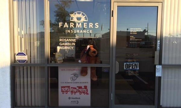 The front door at Rosanne Gamblin Agency, with a Toys for Tots box in the window.