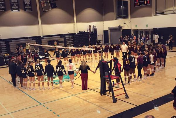 high school volleyball team after a game
