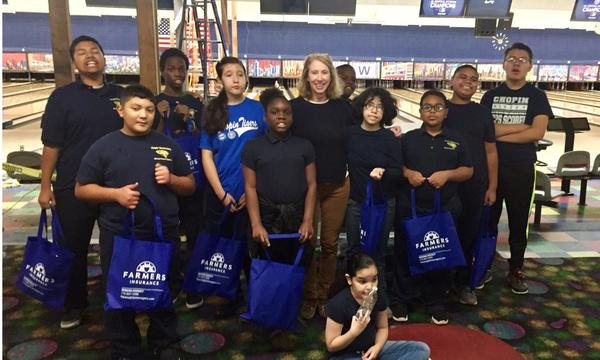 Chopin Elementary autism class smiling in a bowling alley