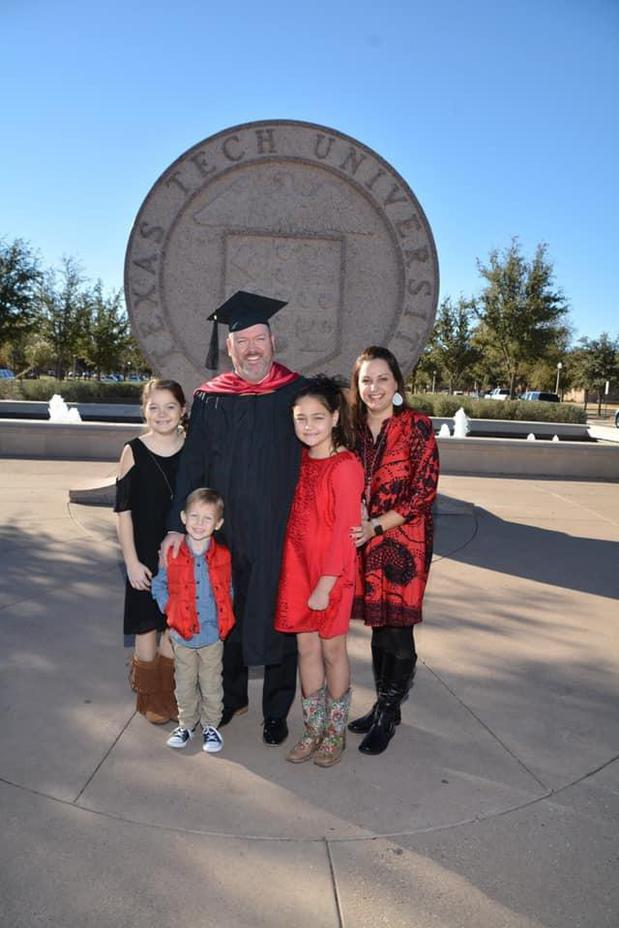 Roach Family at graduation for MBA