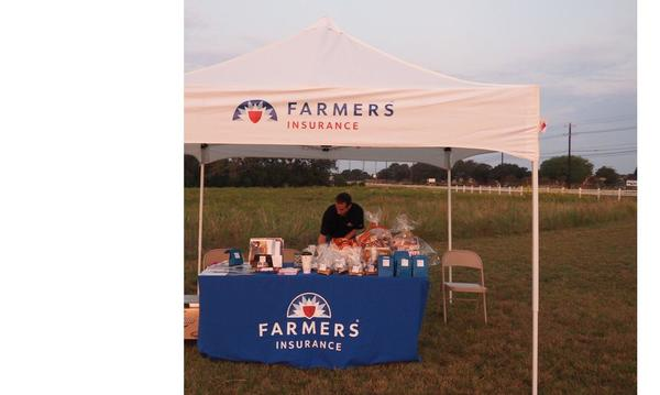 Agent Doug Egolf at his Farmers Insurance table, in Leander, TX, connecting with the community.