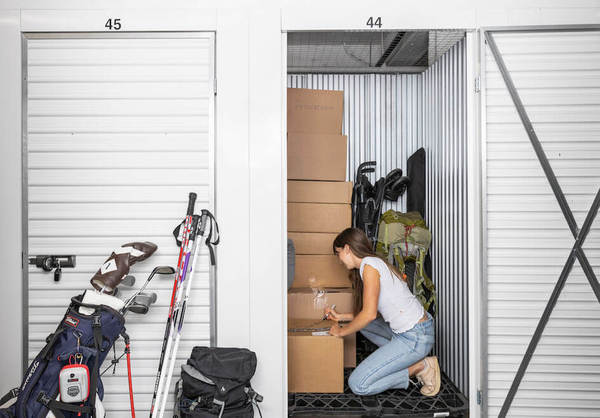 Woman packing storage unit