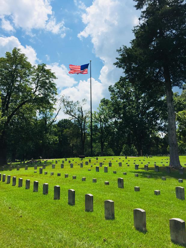 Cemetery  headstones with an american flag