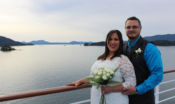 Photo of my wife and I on our wedding day in front of beautiful body of water