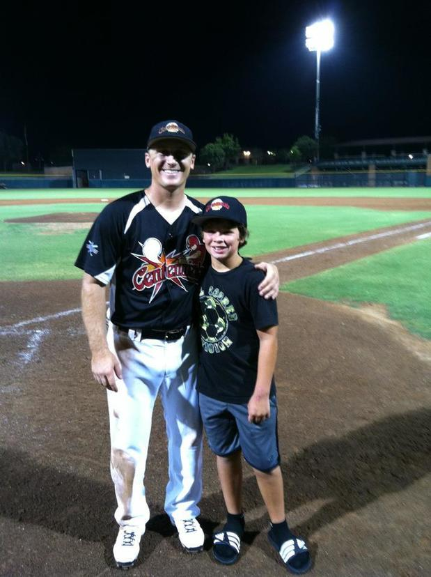 Here I am with my nephew on the baseball field.  My favorite place to be!