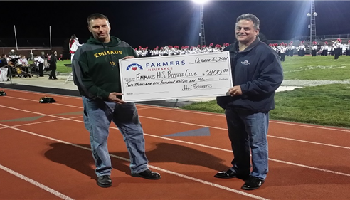 I presented a check for $2100 to Ray Delany - President Emmaus Touchdown Club.