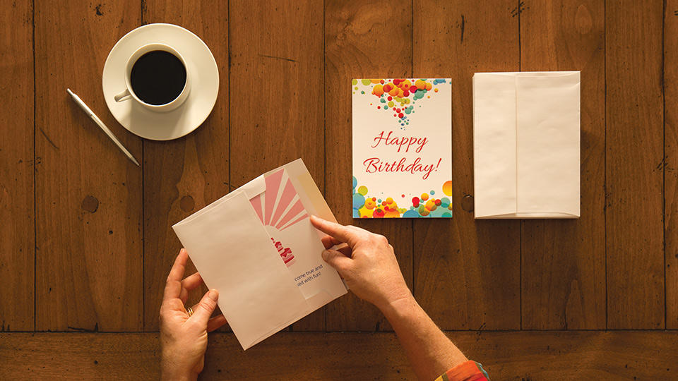 Placing card into envelopes