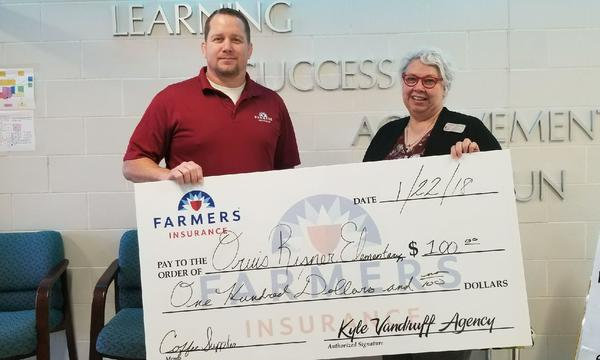Agent and Woman holding an over-sized check