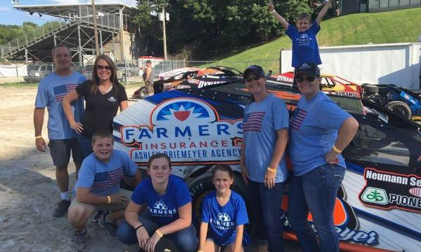 agents and family by farmers sign