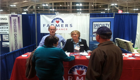 The farmers agents are working the booth at the boat show