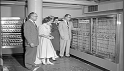 The wall-sized central processing unit of Farmers'® first IBM 705 computer