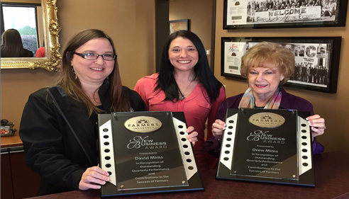 Kim , Cassie and Sara showing off our new business awards !