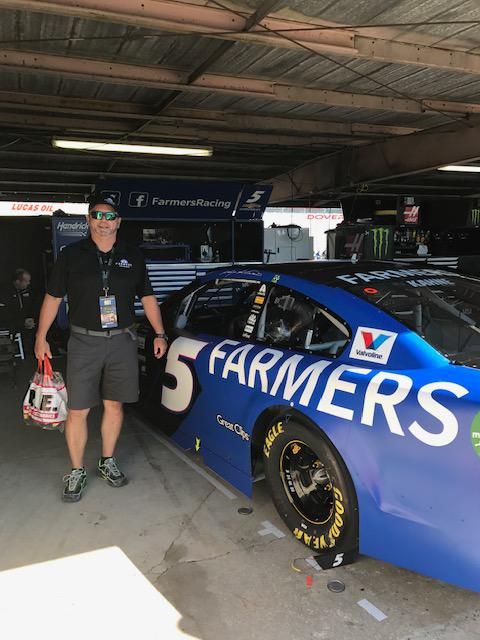 Me with the Farmers Insurance sponsored Nascar race car