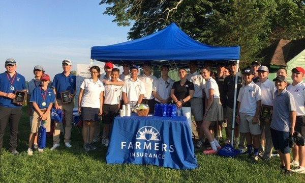 Agent and golf team standing beneath a Farmers tent