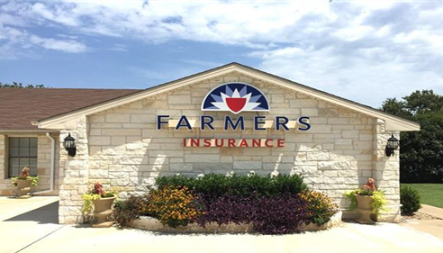 Photo of the outside of the Farmers agency.