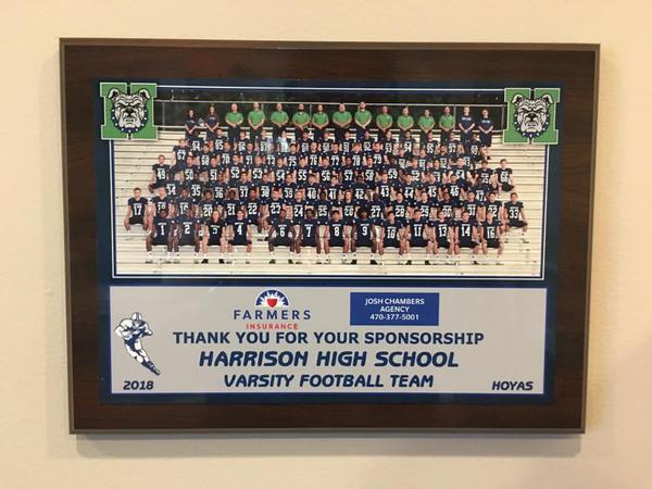 Framed picture of the Harrison Hoyas sitting on bleachers