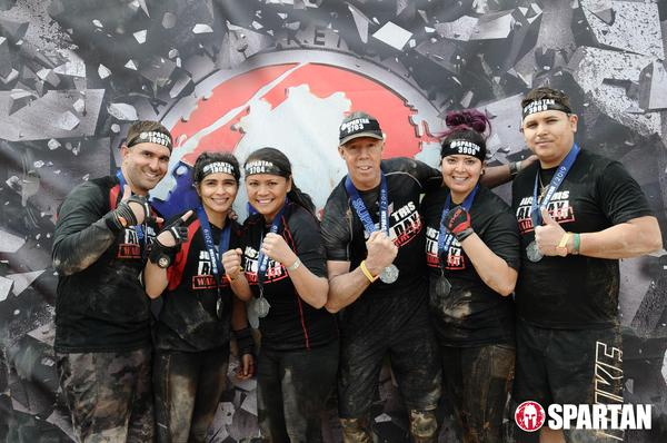 Agents posing at spartan race