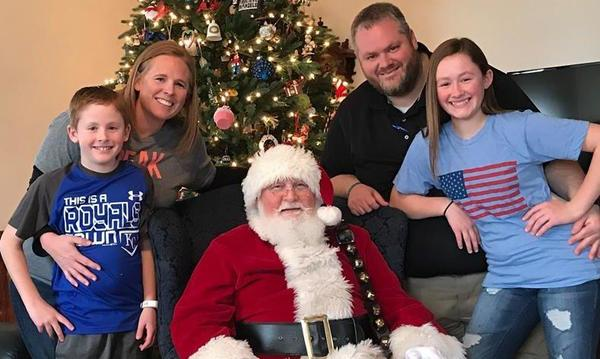 Photo of the family with Santa Claus.