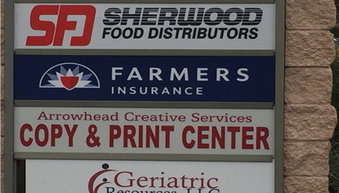 Shopping center sign with Farmers