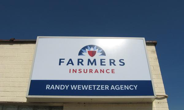 Photo of the agency's sign above a building.
