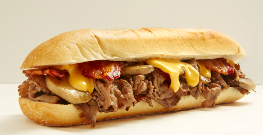 Balboa Cheesesteak sandwich with mushrooms, bacon, and Cheez Whiz