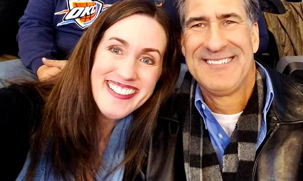Agent and husband at a basketball game