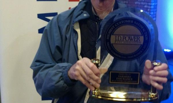 Man holding a JD Power award