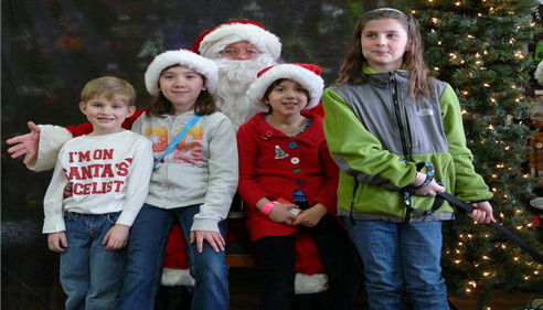 The office employees kids and Santa.