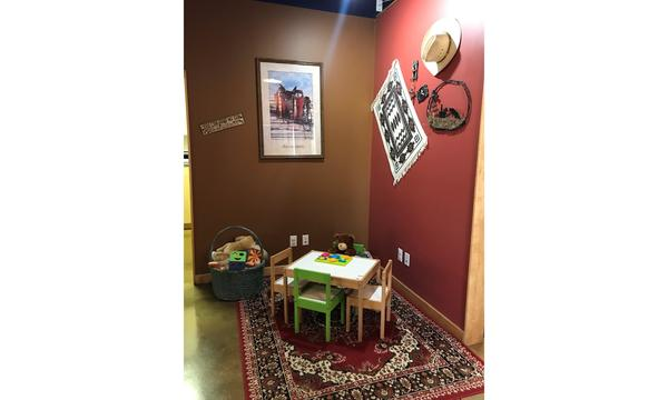 Corner of an office with a kids table and decorative western themed wall fixtures