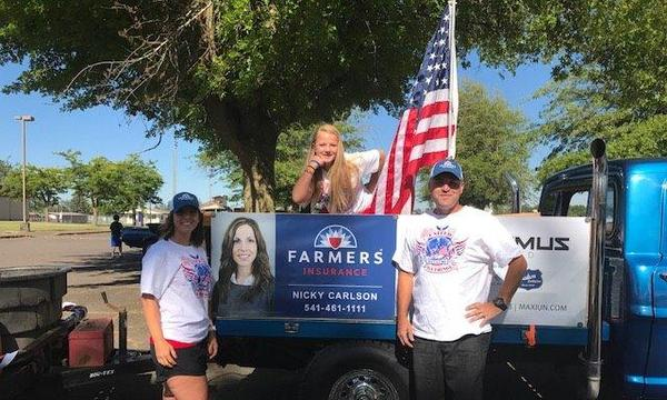 A family of 3 finds a reason to celebrate on their truck - it's America's birthday!