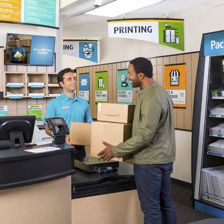 Man at counter with packages to ship