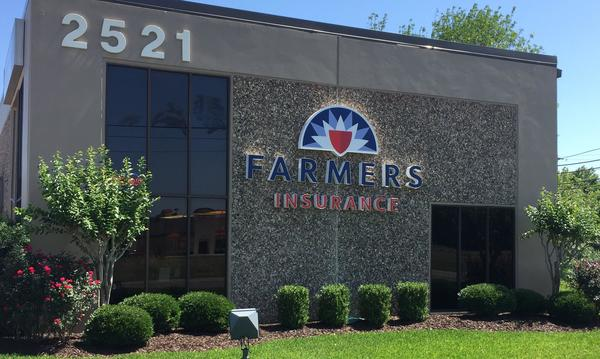 The exterior of the Scott Keithley Agency, displaying the Farmers Insurance logo