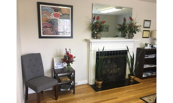 Interior of Farmers agency with fireplace and chair