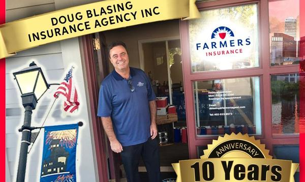 Agent Doug Blasing celebrating his business's 10 year anniversary outside his office.