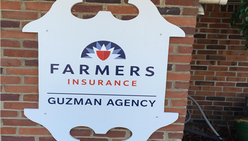 A photo of a Farmers Insurance sign.