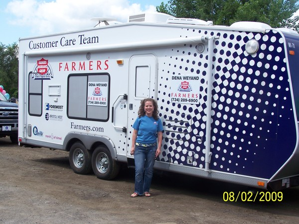 Agent in front of Farmers RV Customer Care Team truck.