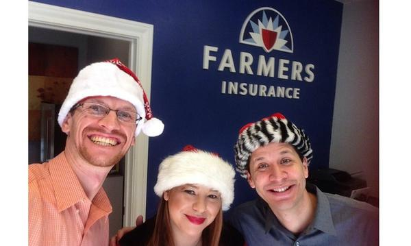 A photo of the Agency staff - three people in Santa hats smile at the camera