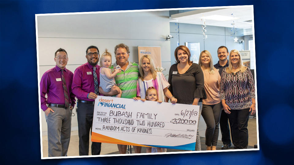 Bubash family accepts a check from Desert Financial employee's for Random Acts of Kindness.