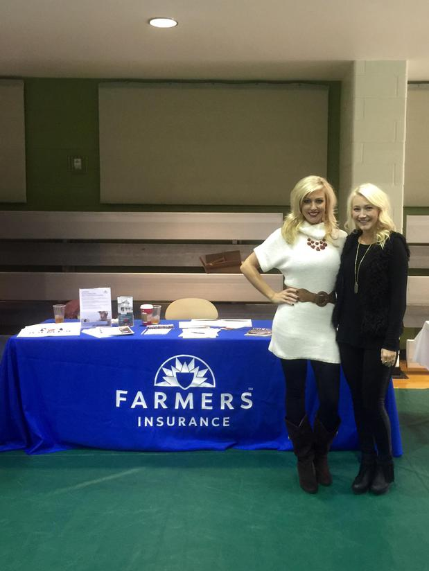 two blonde women standing in front of Farmers table