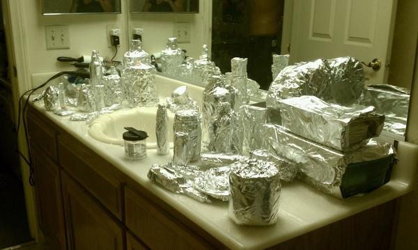 All bathroom items wrapped in aluminum foil