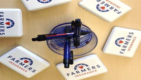 Pens surrounded by boxes with the Farmers logo on them