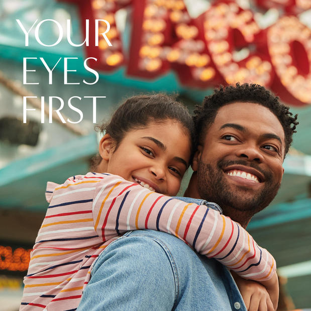 Man and young child smiling while wearing LensCrafters contact lenses