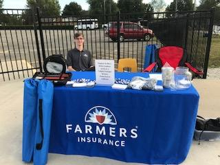 Farmers Insurance booth at football game