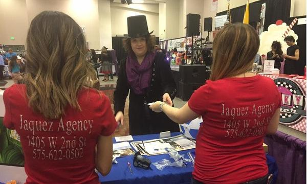 Ana Jaquez Agency handing out materials at their table at the Civic Center BabyBoomer Expo