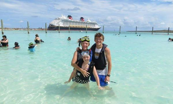 Kids and I standing in the water at Castaway Cay