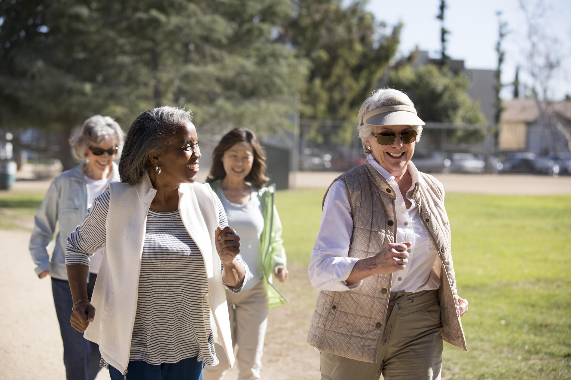 Senior women walking on sunny day